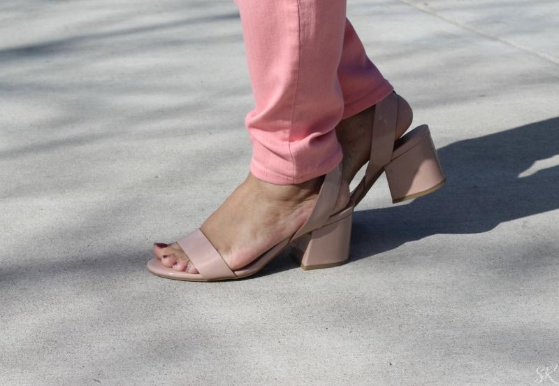 a woman wearing tan heeled sandals