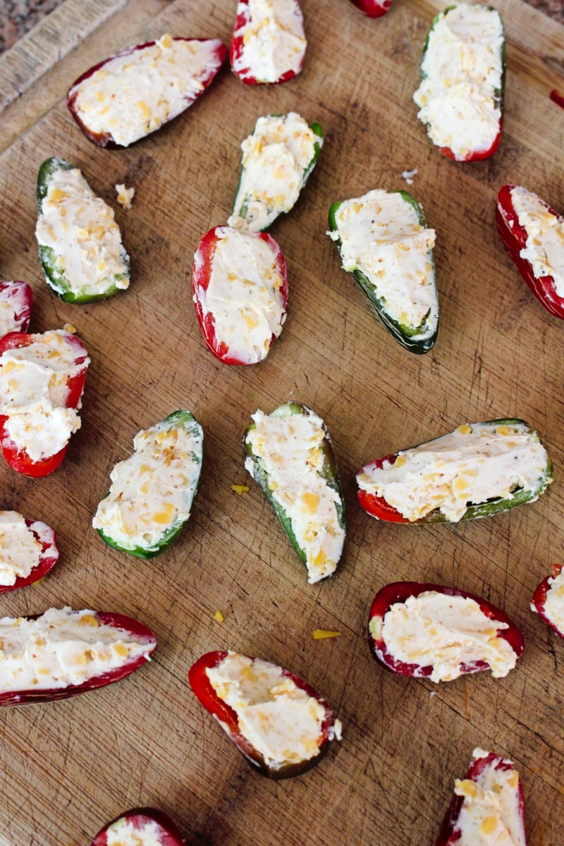 Baked Jalapeño Poppers are a healthier version of fried jalapeño poppers! Fresh stuffed jalapenos are rolled in panko breadcrumbs and baked in the oven until the outside is golden and crispy and the inside is melty and cheesy. #appetizer #jalapenos