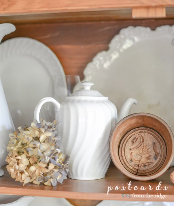 vintage white ironstone, dried hydrangeas, and wooden butter mold