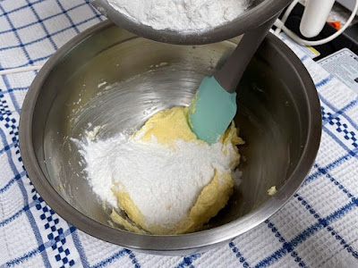 Adding the flour to creamed butter mixture