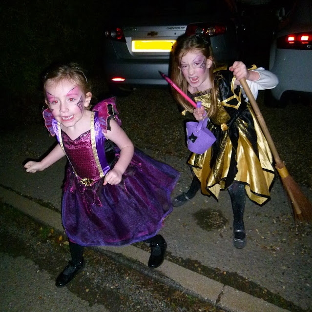 stephs two girls in witch dresses