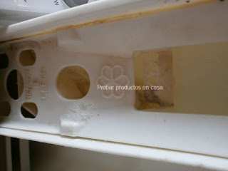 limpiar cajón de la lavadora