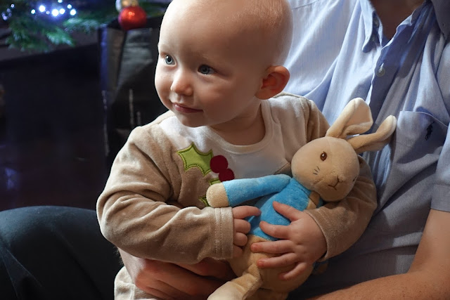 Baby hugging Peter Rabbit