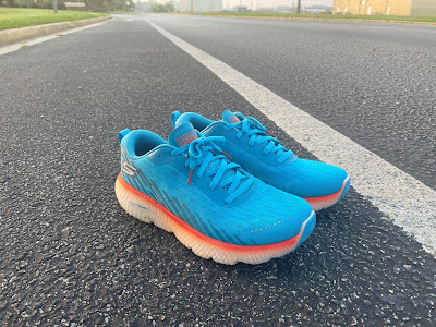 Baby blue pair of Skechers Maxroad 5 on the road