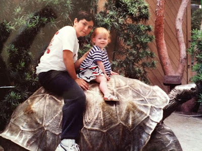 Erica and Nate riding the big bronze tortoise at the world famous San Diego Zoo