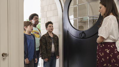 Molly Gordon opens the door for Jacob Tremblay, Keith L. Williams, and Brady Noon in a movie still for Point GreyPictures's film Good Boys