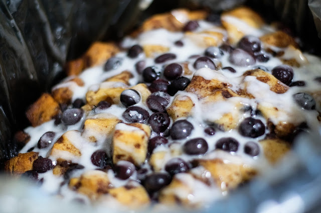 The finished crockpot blueberry cinnamon bake with the icing drizzled all over it.