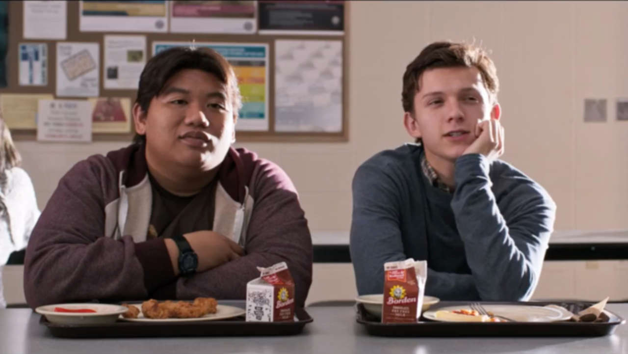 Jacob Batalon as Ned Leeds and Tom Holland as Spider-Man