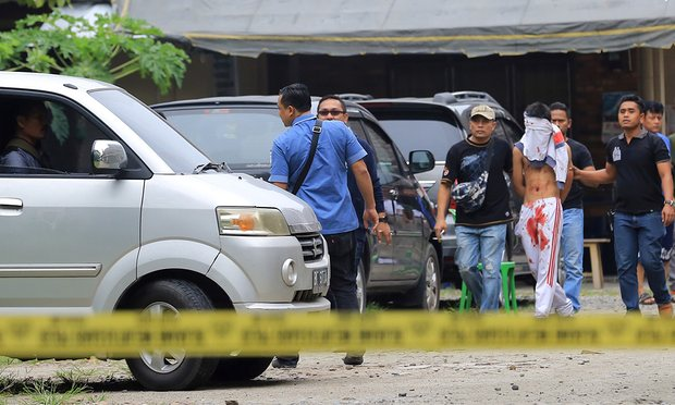 Man armed with suicide bomb and axe attacks church in Indonesia