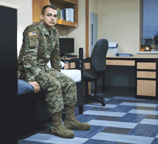 Soldier sitting on dorm bed