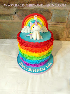 Rainbows and unicorn birthday cake