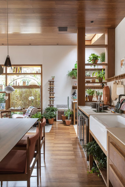 open floor plan with wood kitchen, floors, and paneled ceiling