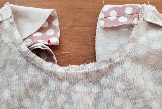 a photograph of the inside neckline of a dress