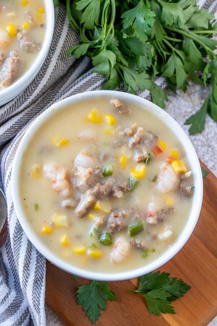 Bowl of chowder with parsley garnish
