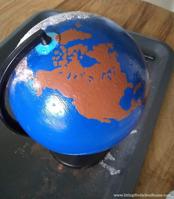 DIY Montessori Sandpaper Globe with continents painted brown and water blue