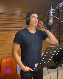 Picture of Daniel Henney working in the studio