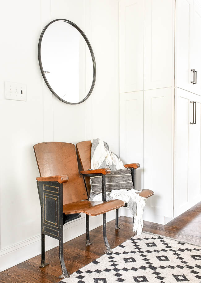 Black modern mirror and vintage theatre seats