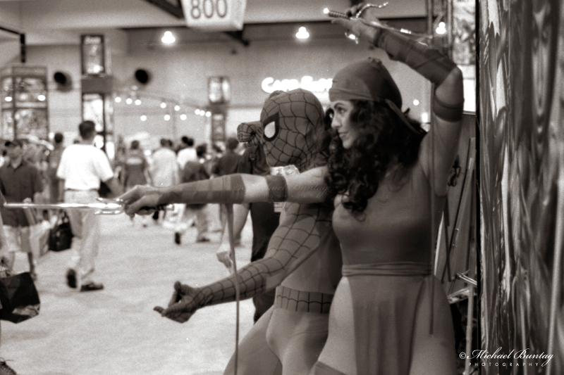 pider-Man, Elektra cosplay, Marvel booth, Comic-Con International, San Diego Convention Center, Marina District, San Diego, California. Ilford HP5+ Black and White 35mm negative film.  © Michael Buntag.