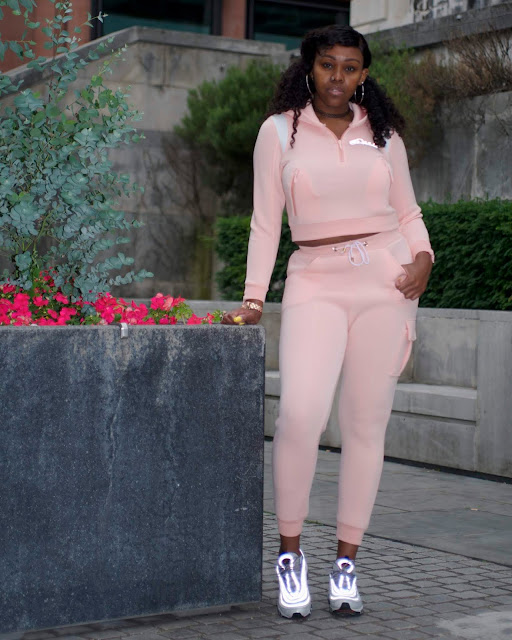 pink tracksuit standing
