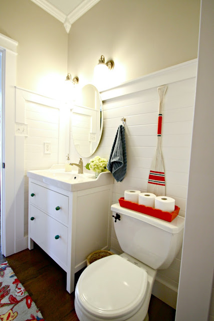 Bathroom with wood planked white walls