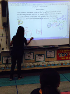 A student who solved the problem a different way now shows her peers her helpful strategy.
