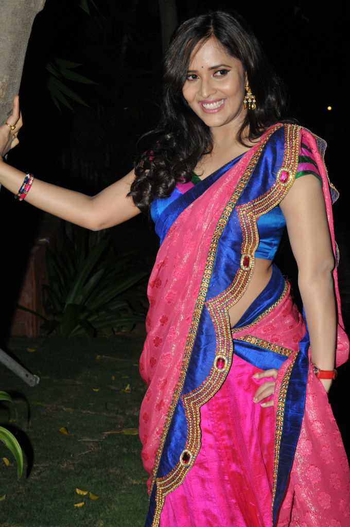 Telugu Tv Anchor Anasuya Latest Images In Pink Saree