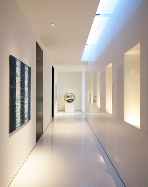 White hallway with art on the wall