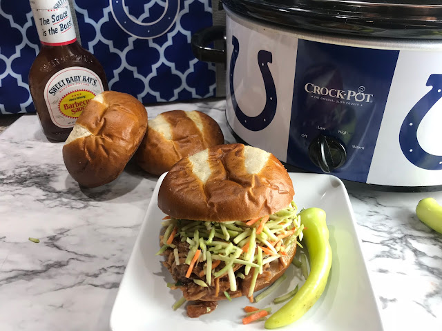 Making pulled pork in the crock pot is a simple meal.   Crock Pot Pulled Pork BBQ is a crowd favorite recipe to plan in advance for harvest, or bring to the game! Chasing Saturdays.