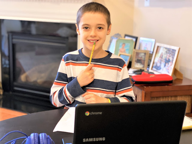My son with his Chromebook
