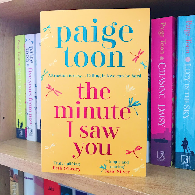 The Minute I Saw You by Paige Toon on bookshelf with books in background