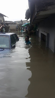 Man smiles as his house gets flooded in Lagos