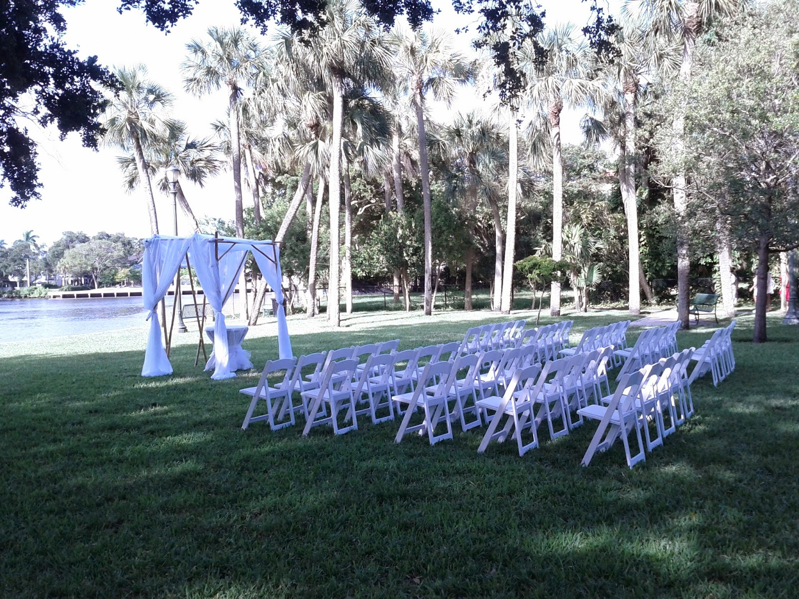 Wedding ceremony seup with bamboo gazebo, white drape, chairs