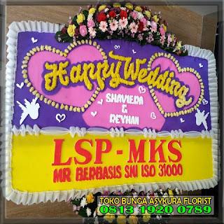 Ucapan bunga papan heppy wedding