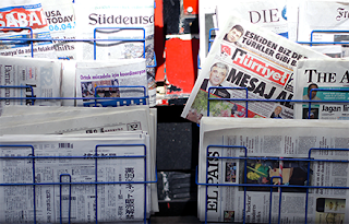 Newspaper stand with newspapers in various languages