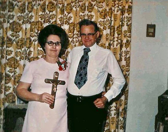 Snapshot of a couple in Sunday best holding a cross. c.1960s Limitations of Skype? marchmatron.com