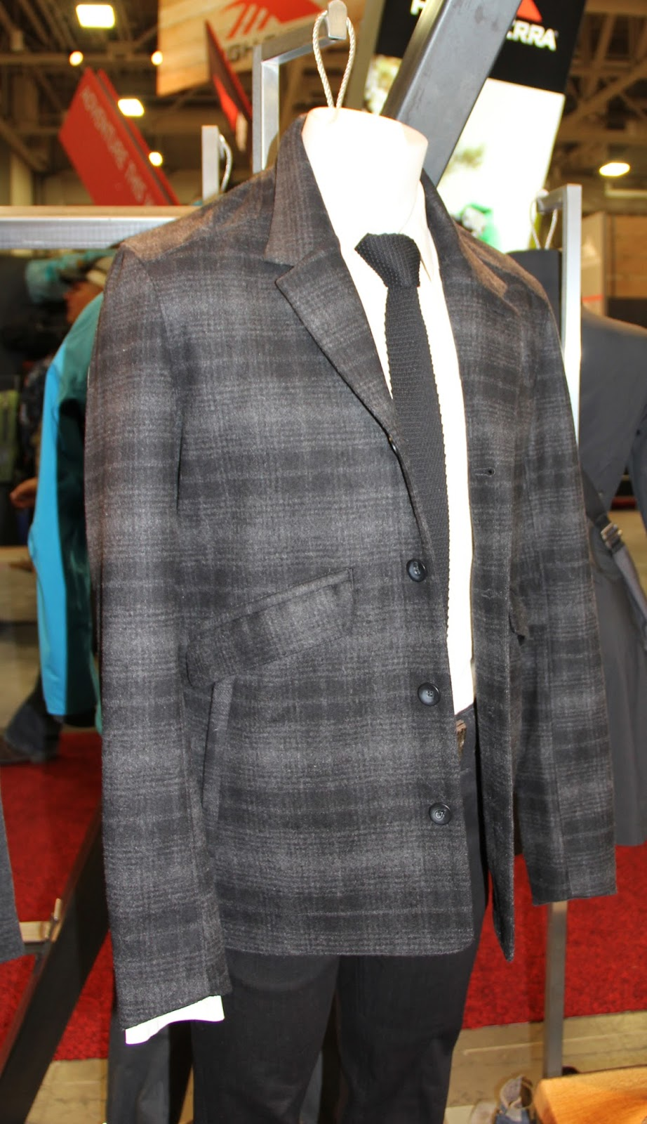c631faeb7e9 ... blend finished with a weather tough DWR treatment, 2 tone plaid  pattern-clean blazer silhouette---multiple pockets…hand warmer and front  flap/interior…