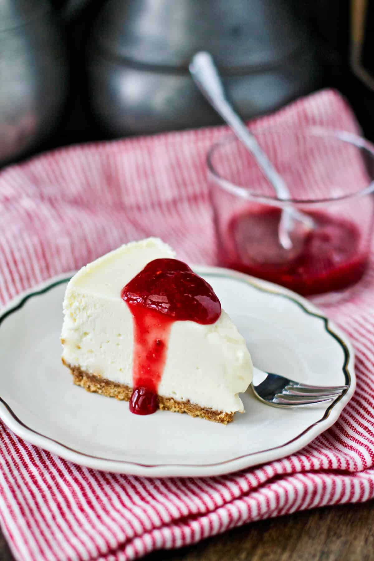 Instant Pot Vanilla Cheesecake with raspberries.