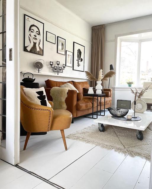 neutral bohemian living room with white modern donut vase