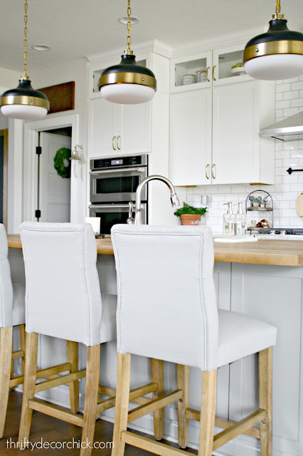 Soothing light gray and white kitchen with wood accents