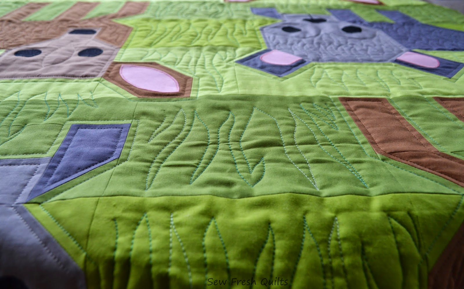 http://sewfreshquilts.blogspot.ca/2014/10/wild-life-finished-top.html