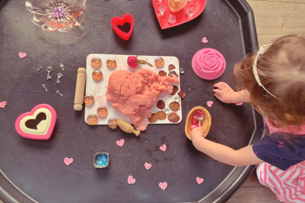 scooping on the Valentine's Day sensory rose playdough tuff tray