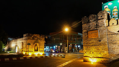 The beautifully illuminated Chiang Mai Gate at night