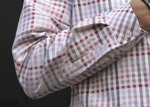 Sleeve placket of a pink and white plaid men's shirt made using the Thread Theory Fairfield Button-Up Shirt sewing pattern.
