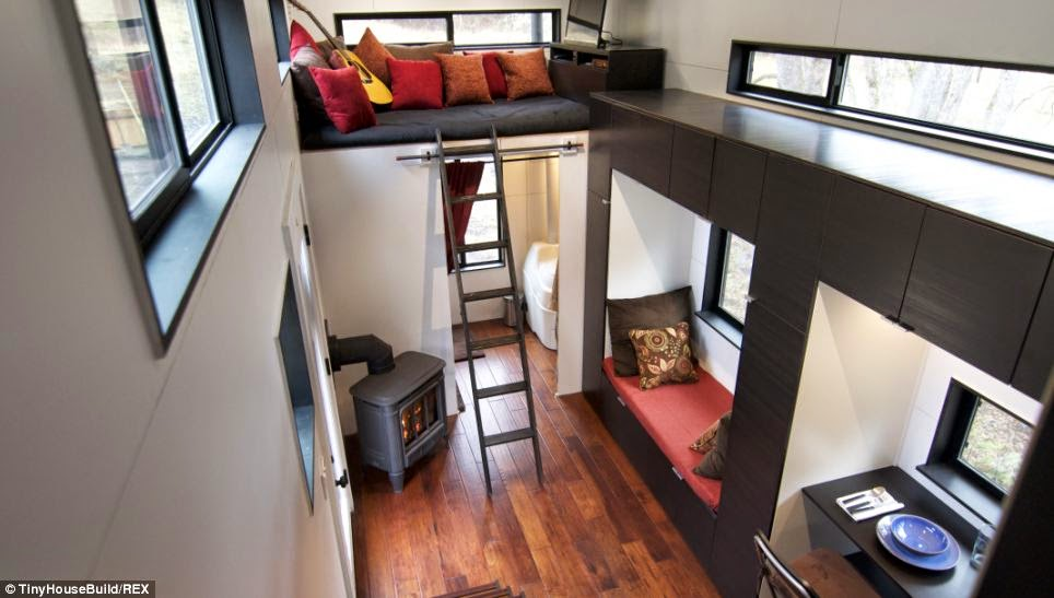 """We are now debt free, off grid, joyful, closer as a family, and enjoying living our lives full time in home."" - This Couple Got Out Of The Rat Race. And Built This Tiny Home For $33K."
