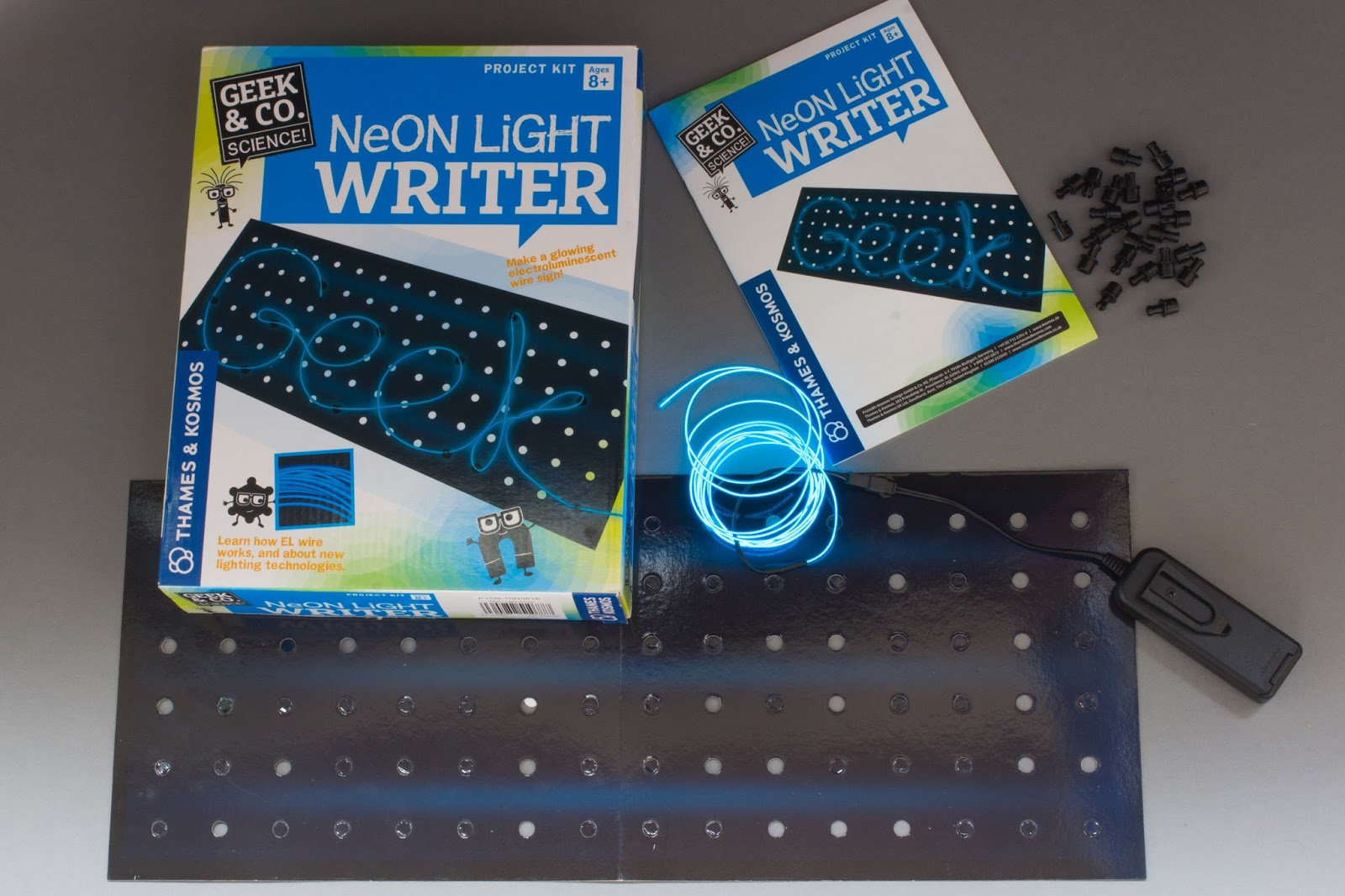 The Neon Light Writer set and the box contents including cardboard peg board, pegs and neon lights