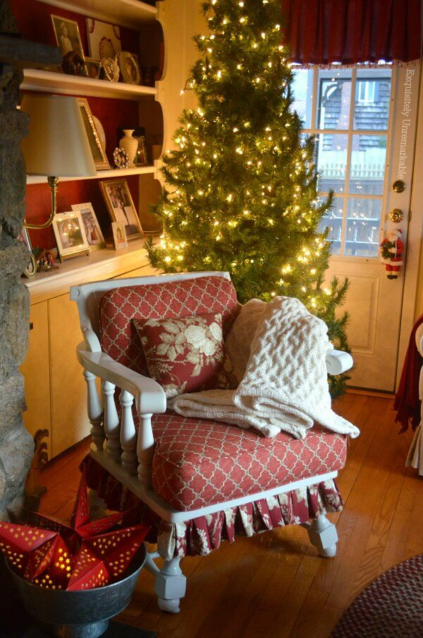 Cottage Style Christmas Chair with skirt in front of lighted tree