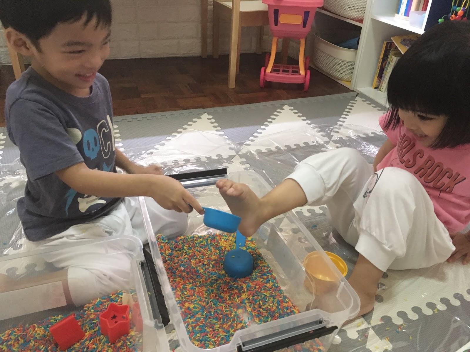 sensory bin rainbow rice play