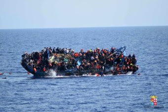 PHOTO: A picture of an asylum seeker boat capsizing in the Mediterranean last month. (AFP: Marine Militare, file)