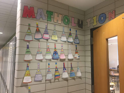 Such a colorful and happy hall display from Ms. Gerber of her students' matholution pennants