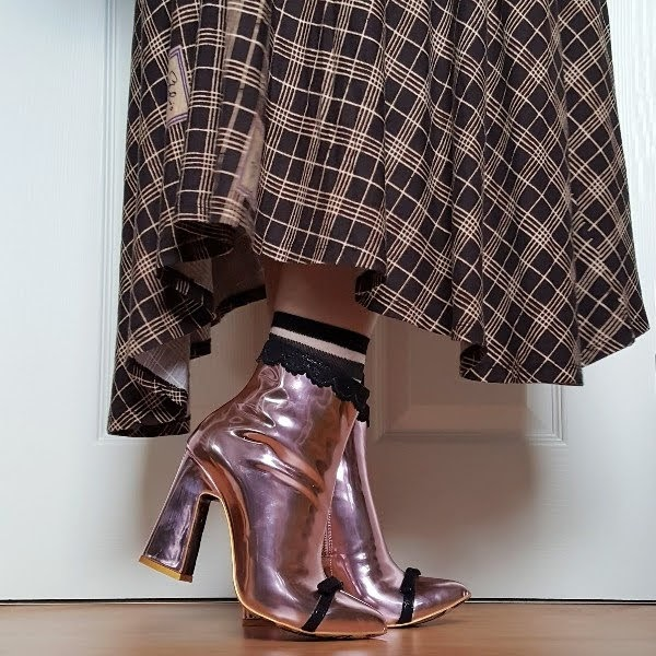 wearing pink metallic ankle boots with checked jersey dress
